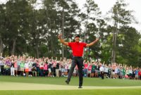 Tiger Woods of the United States celebrates after making his putt on the 18th green to win the Masters at Augusta National Golf Club on April 14, 2019 in Augusta, Georgia. (Photo by Kevin C. Cox/Getty Images)