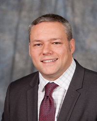 headshot of Rick Dente , COO and GM of St. Andrews Country Club Boca Raton
