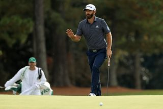Dustin Johnson of the United States waves as he walks to the 18th green during the final round of the Masters at Augusta National Golf Club on November 15, 2020 in Augusta, Georgia.